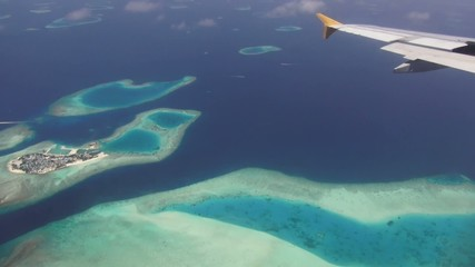 Plane flying over maldives island