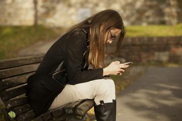 Beautiful Girl Using Mobile Phone Outdoor