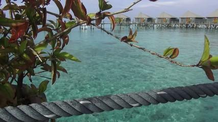 Footage of water villa holiday resorts in maldives