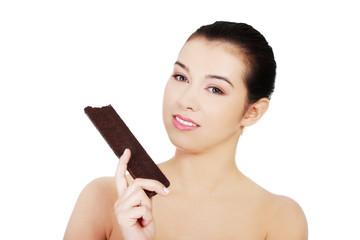 Woman holding a waffer