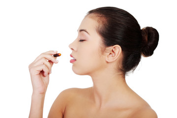 Woman taking pill