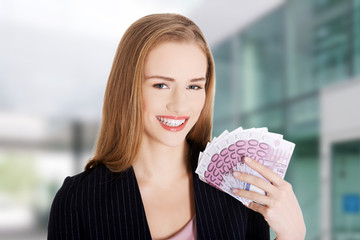 Woman holding money clip