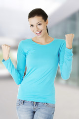Woman posing in blue shirt