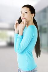 Young beautiful woman talking through phone.