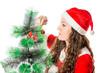 Christmas. Beautiful woman in santa costume and christmas tree