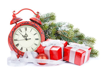 Christmas gift boxes, clock and snow fir tree