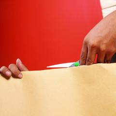 hand cutting a paper