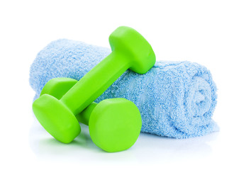 Two green dumbells and towel