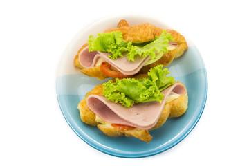 croissant ham cheese on white background