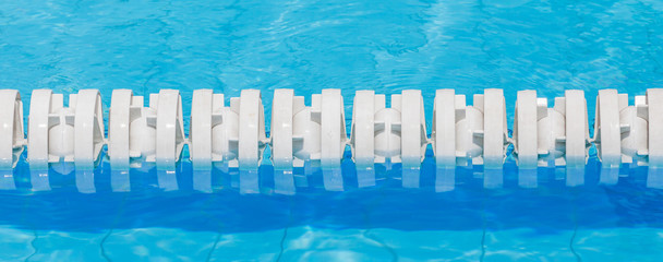 Closeup of white lane rope in swimming pool for competitions.