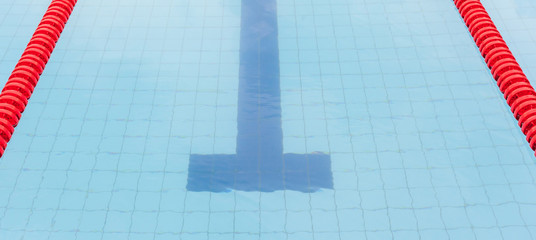 The swimming pool with red marked lanes for swimming competition