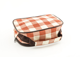 Plaid fabric bag on white background