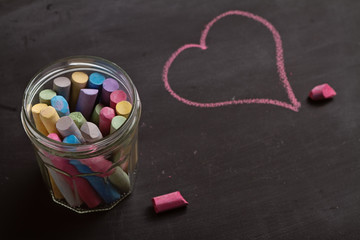 Blackboard, chalk and heart shape drawing