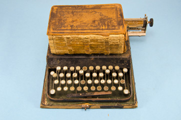 antique typewriter and old book