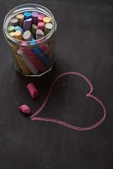 Blackboard, chalk and heart shape drawing vertical