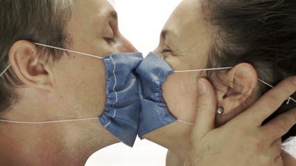 Couple Wearing Medical Masks Kissing