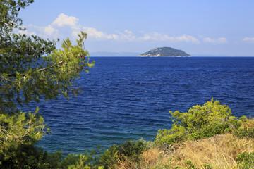 Beautiful Kelyfos (Turtle) Island in Aegean Sea.