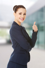Happy business woman with thumb up