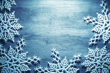 Snowflakes on wooden background