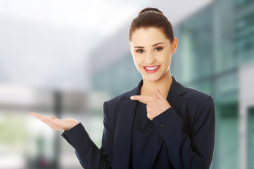 Business woman showing copyspace