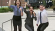 Happy businesspeople showing thumbs, slow motion, steadycam