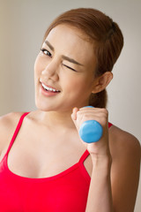 smiling woman with dumbbell concept of  working out, fitness