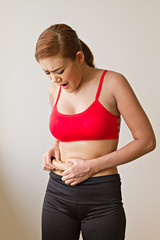 unhappy woman with excessive fat at her waist