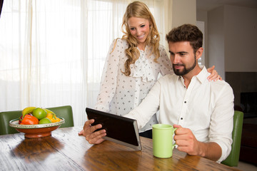 Couple watching a video on the internet while having breakfast