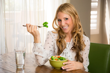 Woman with perfect skin eating a healthy meal