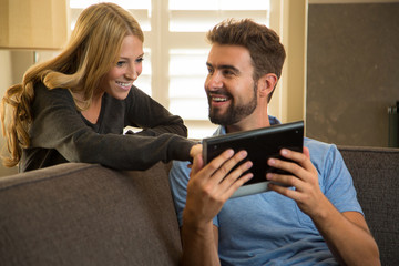 Couple surfing the internet with a tablet