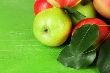 Ripe apples on wooden background