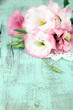 Beautiful eustoma flower on wooden background