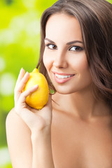 Young happy smiling woman with limon, outdoors