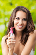 Portrait of woman with body lotion, outdoor