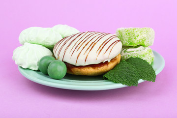 Mint color meringues, mint candies and tasty cake