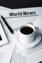 On-line news concept. Computer mouse, PC tablet, cup of coffee