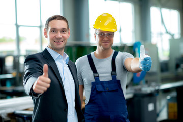 good teamwork in factory with thumbs up