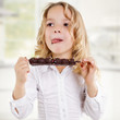 canvas print picture - Kind ißt Schokolade