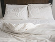 Unmade bed and pillow bedroom interior top view