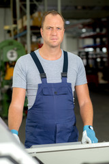 young worker in factory
