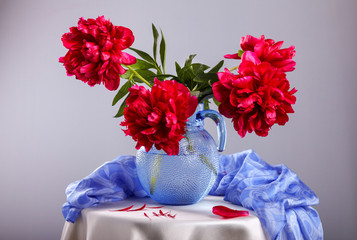 Still life with beautiful purple peonies in  vase