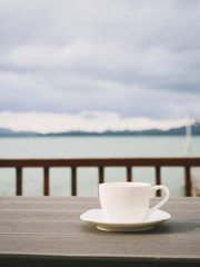 coffee on table beach sea sky background