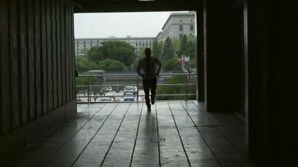 Businessman running to work, slow motion 240fps, steadycam shot
