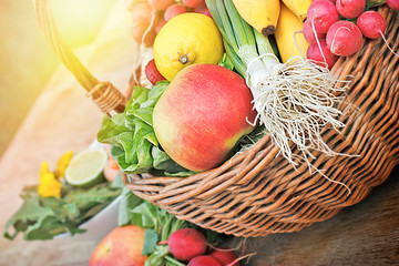 Fresh fruits and vegetables in wicker basket