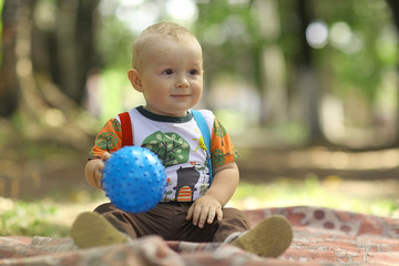 child playing with Ball in a summer park