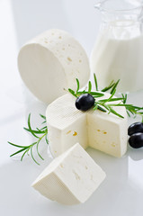 White paneer cheese with rosemary and black olives