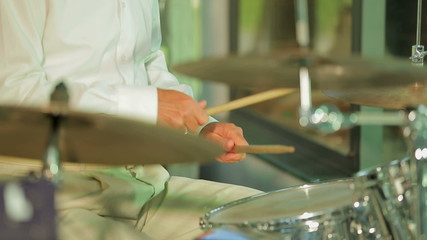 Drummer Playing His Insrument In Concert
