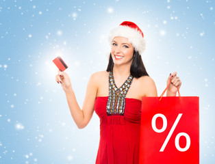 Young and beautiful Christmas shopper girl with the credit card