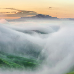 Top of the mountain surrounded by mists