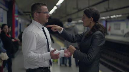 Business colleagues argue on platform, slow motion, steadycam